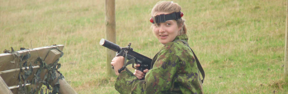 A member of community action playing paintball