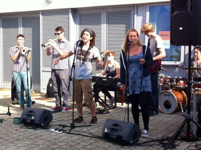 An outdoor performance by members of Music Week during Freshers' Week